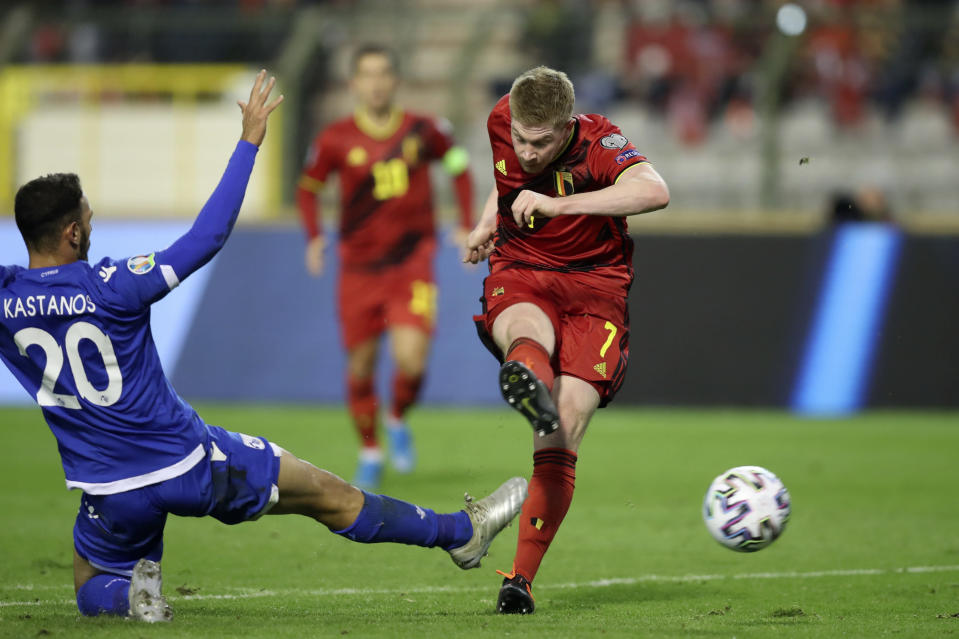 Belgium's Kevin De Bruyne, right, scores his side's third goal during the Euro 2020 group I qualifying soccer match between Belgium and Cyprus at the King Baudouin stadium in Brussels, Tuesday, Nov. 19, 2019. (AP Photo/Francisco Seco)
