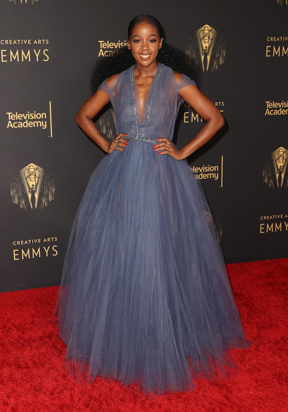 The actor wore a dusty blue tulle gown with sparkly silver piping and kept the glam moment going with a classic red manicure.