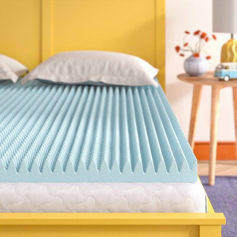 """<h2>77% Off Wayfair Sleep 3"""" Gel Memory Foam Mattress Topper</h2><strong><br>4.6 out of 5 stars and 1,987 reviews</strong><br>""""After sleeping on a regular bed for over 10 years, I took a leap of faith and purchased this 3-inch gel memory foam topper and I can only tell you how amazing it feels to sleep — it's comfortable, cool, and I wake up without a backache.""""<em> – Wayfair Reviewer</em><br><br><em>Shop <strong><a href=""""https://www.wayfair.com/bed-bath/pdp/wayfair-sleep-3-gel-memory-foam-mattress-topper-w004536537.html"""" rel=""""nofollow noopener"""" target=""""_blank"""" data-ylk=""""slk:Wayfair"""" class=""""link rapid-noclick-resp"""">Wayfair</a></strong></em><br><br><strong>Wayfair</strong> Wayfair Sleep 3"""" Gel Memory Foam Mattress Topper, $, available at <a href=""""https://go.skimresources.com/?id=30283X879131&url=https%3A%2F%2Fwww.wayfair.com%2Fbed-bath%2Fpdp%2Fwayfair-sleep-3-gel-memory-foam-mattress-topper-w004536537.html"""" rel=""""nofollow noopener"""" target=""""_blank"""" data-ylk=""""slk:Wayfair"""" class=""""link rapid-noclick-resp"""">Wayfair</a>"""