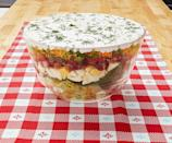 """<p>Heading to a Friendsgiving or holiday potluck? We've got you covered! Bring this salad to your next party in a glass bowl so everyone can see the tasty mix-ins. </p><p><strong><a href=""""https://www.thepioneerwoman.com/food-cooking/recipes/a10214/layered-salad/"""" rel=""""nofollow noopener"""" target=""""_blank"""" data-ylk=""""slk:Get the recipe."""" class=""""link rapid-noclick-resp"""">Get the recipe.</a></strong> </p>"""