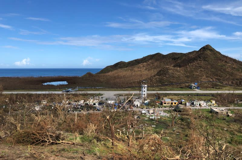 Bare trees are seen next to the runway of Providencia airport after the passing of Storm Iota in Providencia