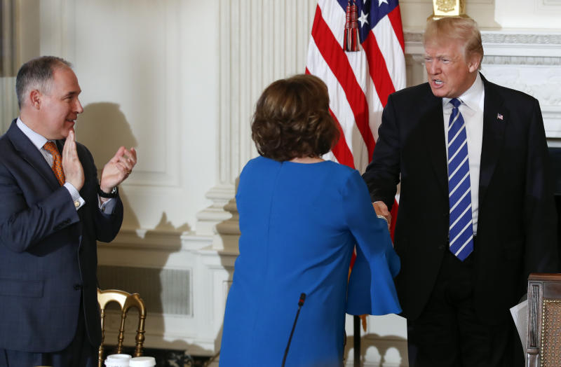 President Donald Trump shakes hands with New Mexico Gov. Susana Martinez, center, as he arrives in the State Dining Room of the White House in Washington, Monday, Feb. 12, 2018, for a meeting with state and local officials about infrastructure. At left is Environmental Protection Agency Administrator Scott Pruitt (AP Photo/Carolyn Kaster)