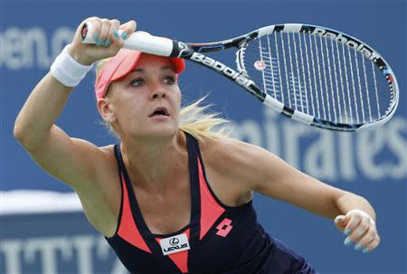 Agnieszka Radwanska of Poland hits a return to Anastasia Pavlyuchenkova of Russia at the U.S. Open tennis championships in New York August 30, 2013. REUTERS/Ray Stubblebine
