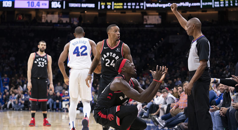 PHILADELPHIA, PA - DECEMBER 08: Pascal Siakam #43 and Norman Powell #24 of the Toronto Raptors react to a call made by referee Michael Smith #38 in the fourth quarter against the Philadelphia 76ers at Wells Fargo Center on December 8, 2019 in Philadelphia, Pennsylvania. The 76ers defeated the Raptors 110-104. NOTE TO USER: User expressly acknowledges and agrees that, by downloading and/or using this photograph, user is consenting to the terms and conditions of the Getty Images License Agreement. (Photo by Mitchell Leff/Getty Images)