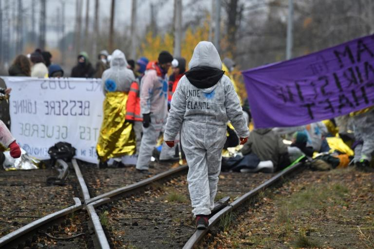 Activists blocked the rail lines in their protest in front of the Jaenschwalde power plant in eastern Germany