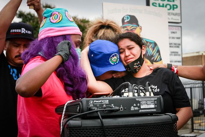 Jennifer Guardado, sister of Andres Guardado, and other relatives of speak at a rally seeking justice for the 18-year-old on June 28, 2020 in Gardena, California. (Photo: Jason Armond via Getty Images)
