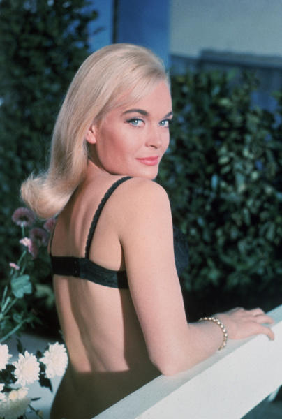 """This undated publicity photo provided by United Artists and Danjaq, LLC shows Honor Blackman as Pussy Galore in the James Bond 1995 film, """"GoldenEye."""" Initially, Bond girls were part of the aesthetic of the series. The film is included in the MGM and 20th Century Fox Home Entertainment Blu-Ray """"Bond 50"""" anniversary set. (AP Photo/United Artists and Danjaq, LLC)"""