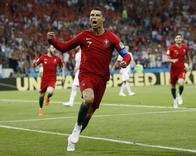 Portugal's Cristiano Ronaldo celebrates after scoring against Spain during World Cup Group B action. (AP)