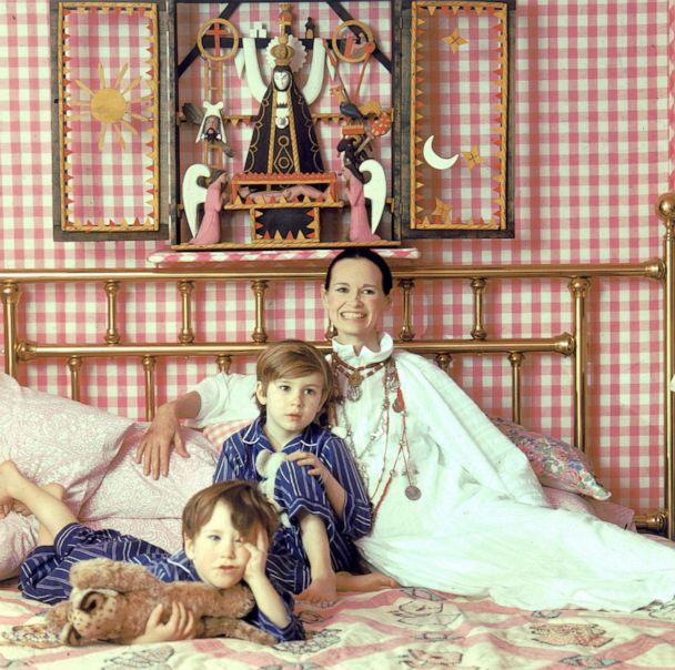 PHOTO: Socialite and heiress Gloria Vanderbilt poses for a portrait session with her sons Anderson Cooper (left) and Carter Vanderbilt Cooper on a bed in their home, March 30, 1972, in Southampton, Long Island, New York. (Jack Robinson/Hulton Archive/Getty Images)
