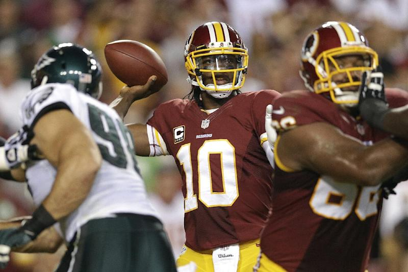 Washington Redskins quarterback Robert Griffin III (10) passes the ball during the first half of an NFL football game against the Philadelphia Eagles in Landover, Md., Monday, Sept. 9, 2013. (AP Photo/Patrick Semansky)