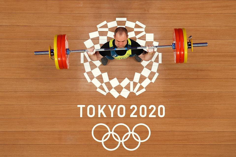 <p>Brandon Dean Wakeling of Team Australia competes during the Weightlifting - Men's 73kg Group B on day five of the Tokyo Olympic Games at Tokyo International Forum on July 28, 2021 in Tokyo, Japan. (Photo by Chris Graythen/Getty Images)</p>