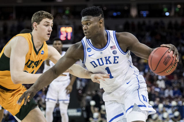 <p>Duke forward Zion Williamson (1) drives against North Dakota State forward Rocky Kreuser, left, during the first half of a first-round game in the NCAA men's college basketball tournament Friday, March 22, 2019, in Columbia, S.C. (AP Photo/Sean Rayford) </p>