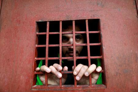 Amaar Hussein, 22,  an Islamic State member  look out from a prison cell  in Sulaimaniya