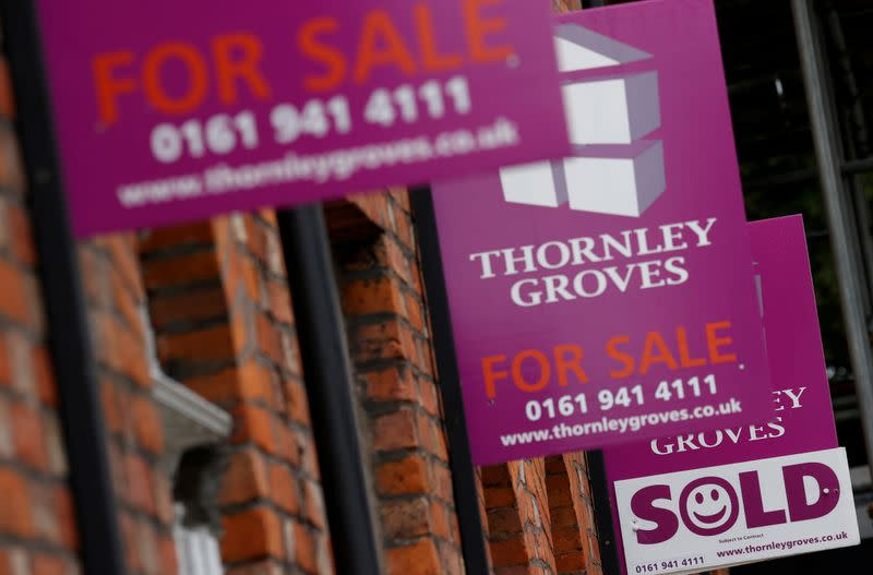 FILE PHOTO: Real estate agents boards are seen outside a row of terraced houses following the outbreak of the coronavirus disease (COVID-19), in Manchester