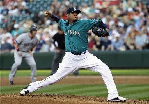 Seattle Mariners starting pitcher Felix Hernandez throws in the second inning of a baseball game against the Boston Red Sox, Monday, July 8, 2013, in Seattle. (AP Photo/Ted S. Warren)