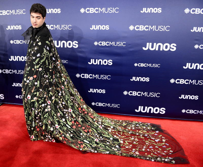 Jeremy Dutcher in a stunning floral cape.