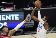 Los Angeles Clippers guard Paul George, right, shoots as Washington Wizards forward Rui Hachimura defends during the first half of an NBA basketball game Tuesday, Feb. 23, 2021, in Los Angeles. (AP Photo/Mark J. Terrill)