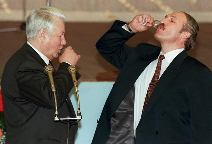 FILE In this file photo taken on Tuesday, April 2, 1996, Russian President Boris Yeltsin, left, and Belarussian President Alexander Lukashenko drink vodka after a toast celebrating the signing of an agreement in the Kremlin in Moscow, Russia. Lukashenko faces a perfect storm as he seeks a sixth term in the election held Sunday, Aug. 9, 2020 after 26 years in office. Mounting public discontent over the worsening economy and his government's bungled handling of the coronavirus pandemic has fueled the largest opposition rallies since the Soviet collapse. (Pool Photo via AP, File)