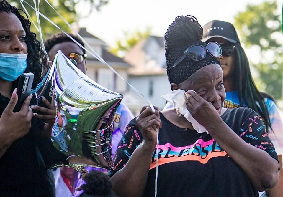 Friends and family members listen to Quiana Martin speaks about the life of her mother, Shirley Muhammad during the vigil to celebrate her life and the lives of Jaelin Ransom and Tyla Ransom, Thursday, July 29, 2021 at Stanford Brown Park in Kansas City. Friends and family gathered to let go of balloons and celebrate their loved ones lives.