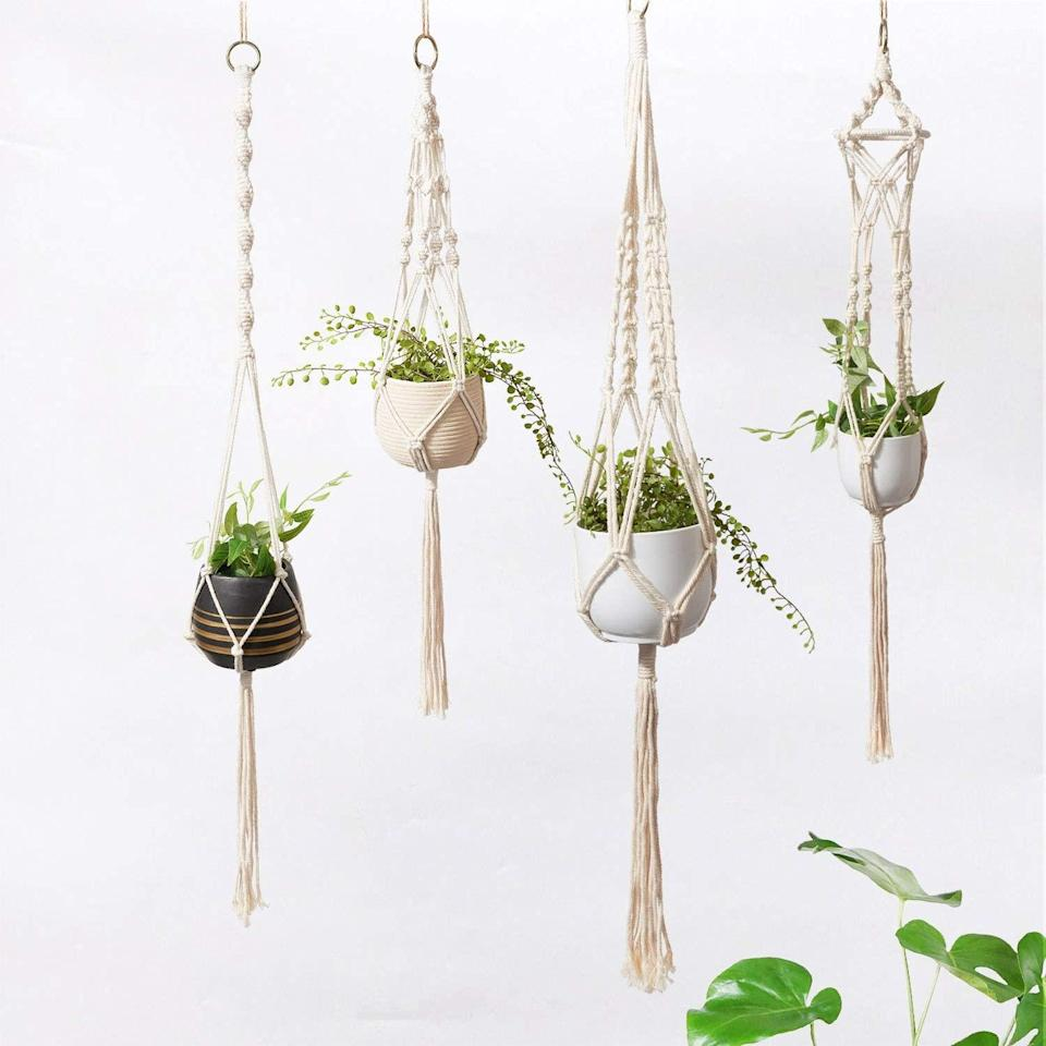 """<h2>Timeyard Macrame Plant Hanger Set</h2><br>Arrange this four-pack of intricately woven macrame hangers together or scattered apart inside your space as boho-chic resting places for your favorite green potted friends.<br><br><strong>TIMEYARD</strong> Macrame Plant Hanger Set, $, available at <a href=""""https://amzn.to/3al0OZf"""" rel=""""nofollow noopener"""" target=""""_blank"""" data-ylk=""""slk:Amazon"""" class=""""link rapid-noclick-resp"""">Amazon</a>"""
