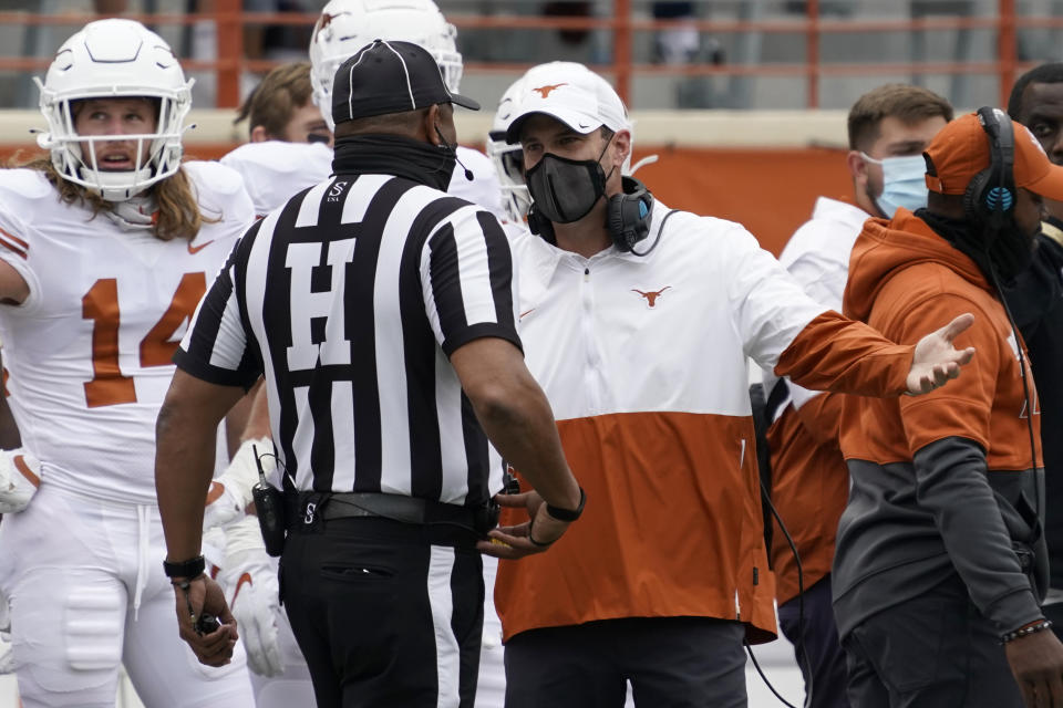 Texas head coach Tom Herman, center right, argues a call during the first half of an NCAA college football game against Baylor in Austin, Texas, Saturday, Oct. 24, 2020. (AP Photo/Chuck Burton)