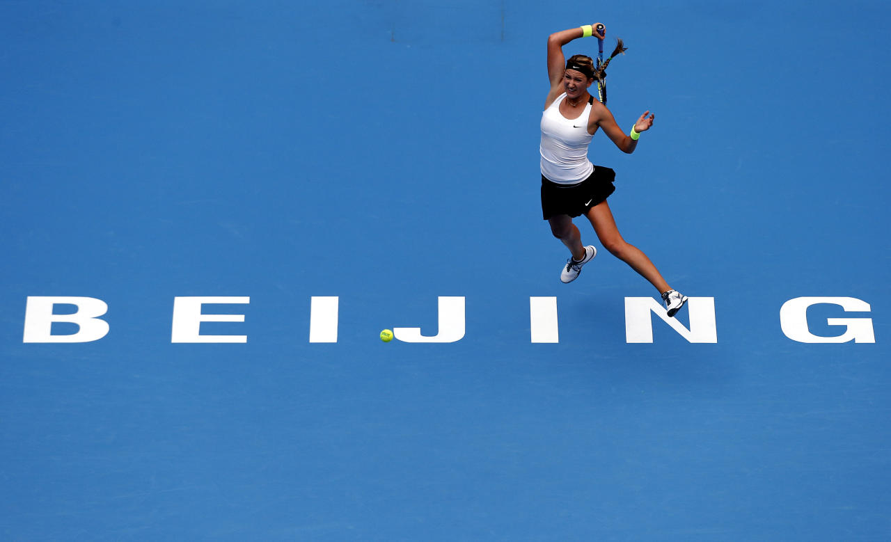 Victoria Azarenka of Belarus hits a return to Alize Cornet of France during their first round match at the China Open tennis tournament in Beijing October 1, 2012.    REUTERS/David Gray     (CHINA - Tags: SPORT TENNIS TPX IMAGES OF THE DAY)