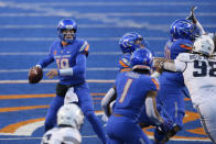 Boise State quarterback Hank Bachmeier (19) looks down field to throw the ball against Utah State during the first half of an NCAA college football game Saturday, Oct. 24, 2020, in Boise, Idaho. Boise State won 42-13. (AP Photo/Steve Conner)