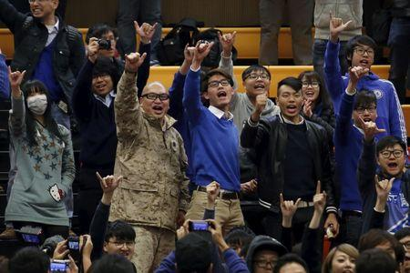 Supporters of Edward Leung, a candidate from the Hong Kong Indigenous, chant slogans during the announcement of the final poll result of a Legislative Council by-election in Hong Kong, China February 29, 2016.   REUTERS/Bobby Yip