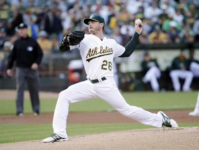 Oakland Athletics starting pitcher Scott Kazmir throws to the Houston Astros during the first inning of a baseball game on Tuesday, July 22, 2014, in Oakland, Calif. (AP Photo)