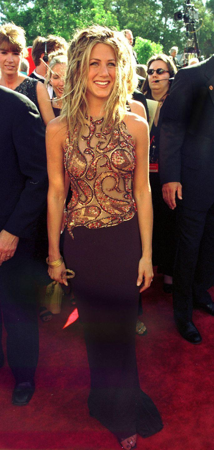 <p>Jen looked absolutely glowing at the 1999 Emmy Awards. Her dress was ornate, but she opted for beachy hair. <em>Friends </em>was nominated for six awards that night, including Outstanding Comedy Series.</p>