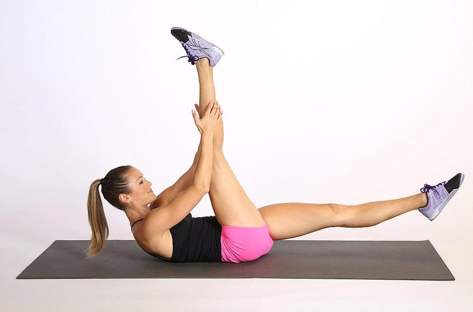 <ul> <li>Lie on your back, and lift your upper body off the floor so your shoulder blades hover.</li> <li>Lift your right leg off the floor, and bring your left leg to 90 degrees, gently holding the left shin. Keep your upper body lifted as you switch or scissor your legs to complete one rep. </li> <li>Continue alternating sides for 45 seconds, then rest for 15.</li> </ul>