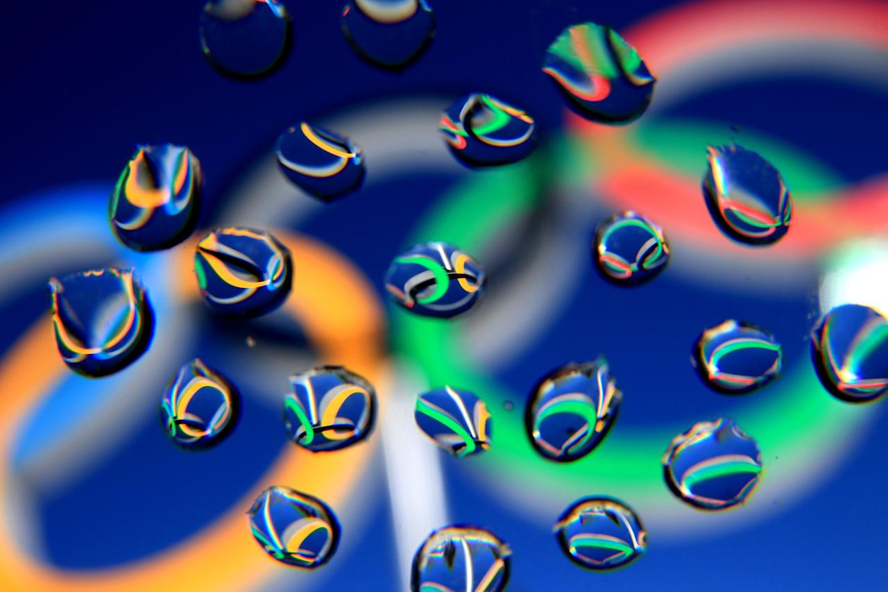 SOCHI, RUSSIA - FEBRUARY 05: The Olympic Rings are seen in water droplets ahead of the Sochi 2014 Winter Olympics at the Laura Cross-Country Ski and Biathlon Center on February 5, 2014 in Sochi, Russia. (Photo by Richard Heathcote/Getty Images)