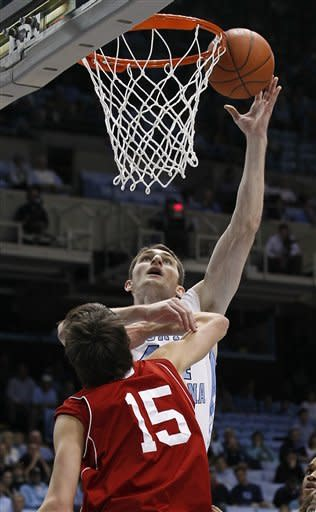 North Carolina's Tyler Zeller shoots over Nicholls State's Sam McBeath (15) during the first half of an NCAA college basketball game in Chapel Hill, N.C., Monday, Dec. 19, 2011. (AP Photo/Gerry Broome)