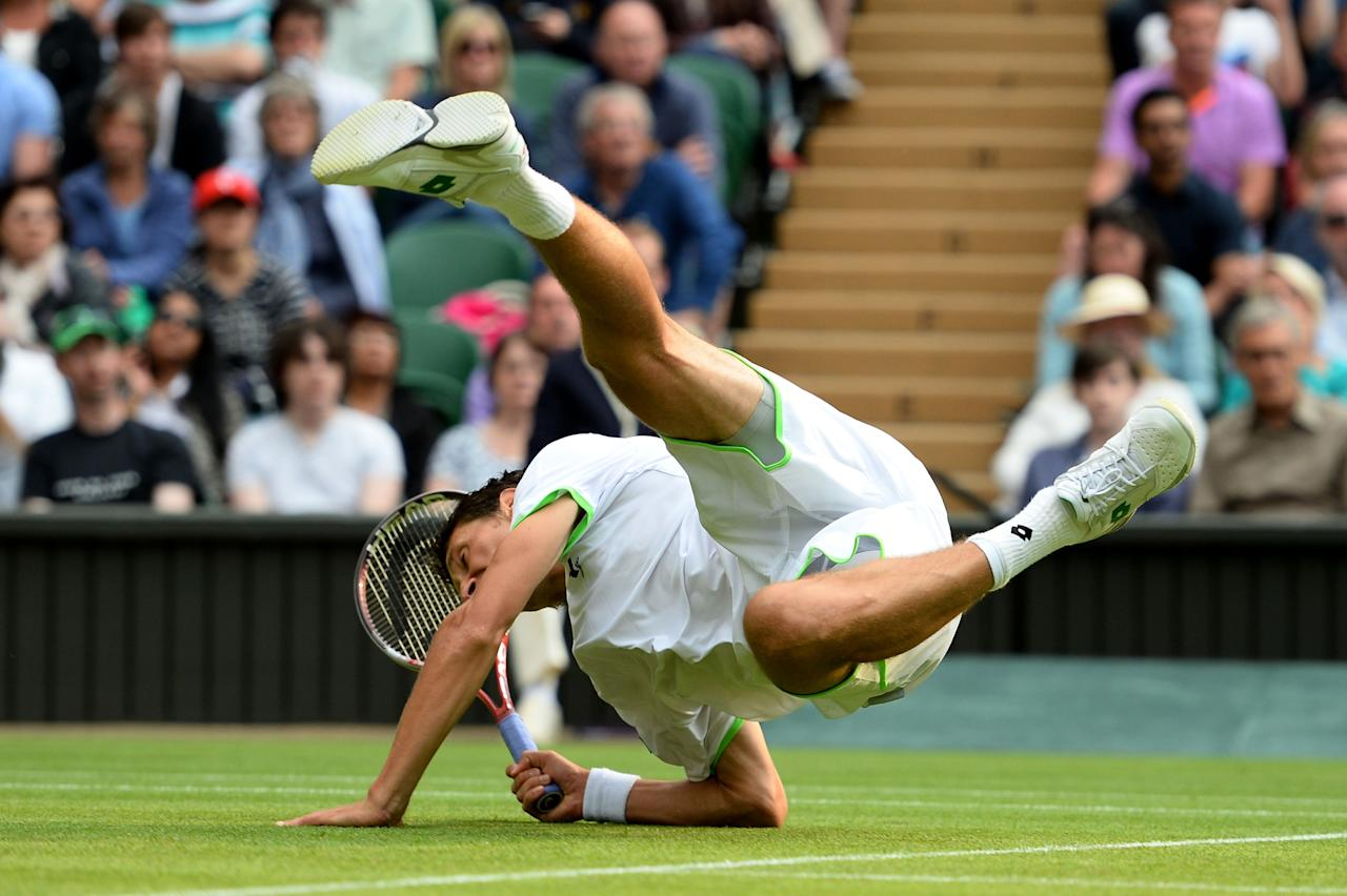 LONDON, ENGLAND - JUNE 26: Sergiy Stakhovsky of Ukraine slips on the grass during his Gentlemen's Singles second round match against Roger Federer of Switzerland on day three of the Wimbledon Lawn Tennis Championships at the All England Lawn Tennis and Croquet Club on June 26, 2013 in London, England. (Photo by Mike Hewitt/Getty Images)