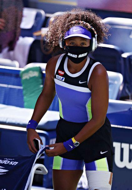 PHOTO: Naomi Osaka wears a mask with Ahmaud Arbery's name as she arrives to play Marta Kostyuk of Ukraine during their match on the fifth day of the US Open Tennis Championships the USTA National Tennis Center in Flushing Meadows, New York, Sept. 2020. (Jason Szenes/EPA via Shutterstock)