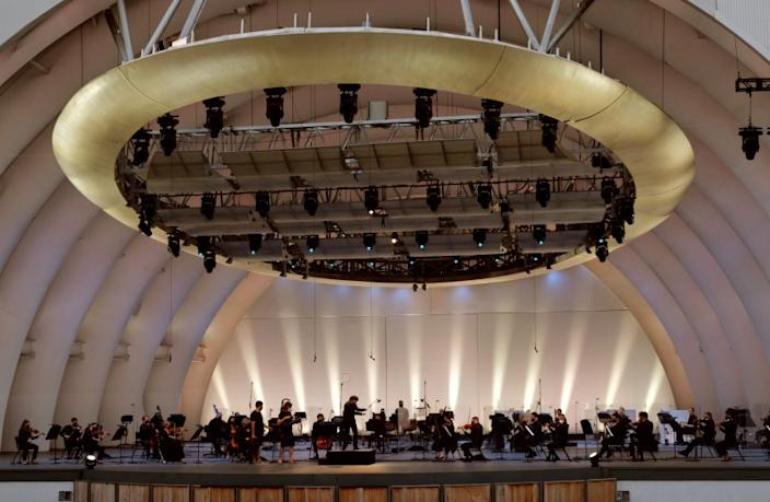 Conductor Gustavo Dudamel and the Los Angeles Philharmonic perform to an empty the Hollywood Bowl n August