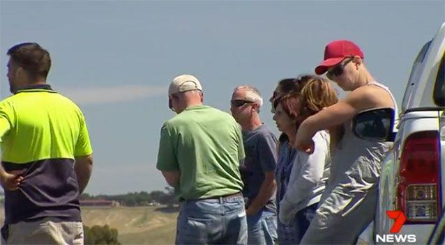 Family and friends help with the search. Source: 7 News