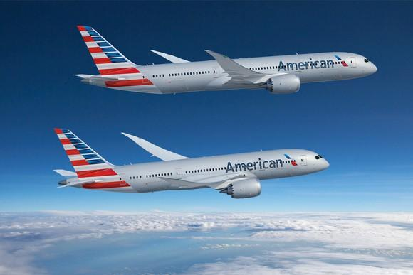 A rendering of a 787-8 and a 787-9 in American Airlines colors flying over clouds