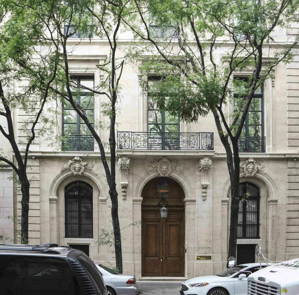 "This photo shows the Manhattan residence of Jeffrey Epstein, Monday July 8, 2019, in New York. Prosecutors said Monday, federal agents investigating wealthy sex offender Jeffrey Epstein found ""nude photographs of what appeared to be underage girls"" while searching his Manhattan mansion. (AP Photo/Bebeto Matthews)"