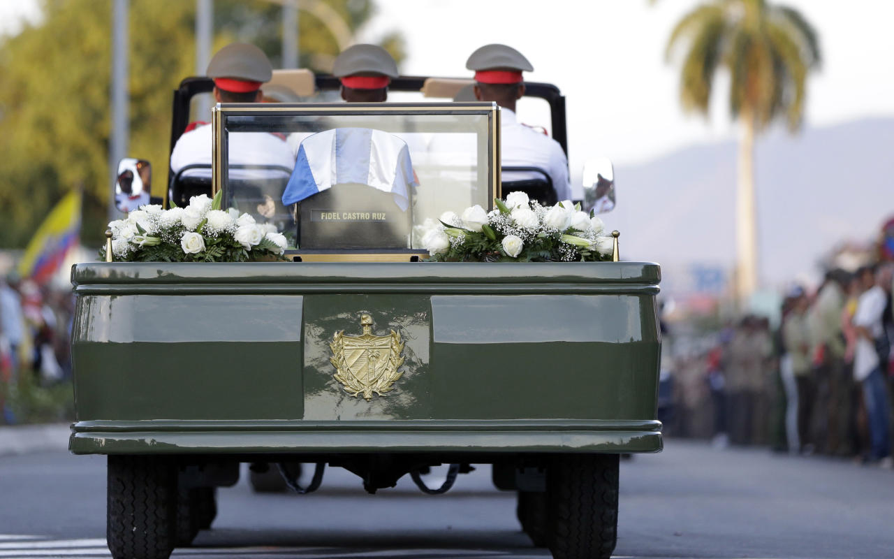 <p> The ashes of Fidel Castro leave the Antonio Maceo plaza for its burial in a private funeral ceremony at the Santa Ifigenia cemetery in Santiago, Cuba Sunday Dec. 4, 2016.(AP Photo/Natacha Pisarenko) </p>