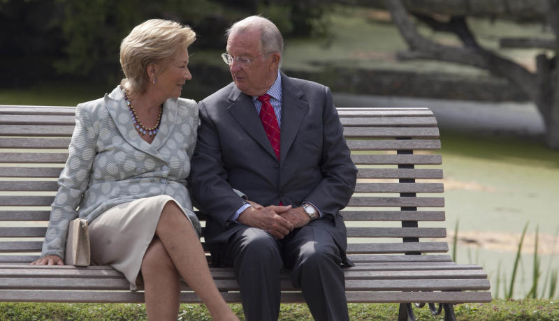File - In this Sunday, Sept. 2, 2012 file photo, Belgium's King Albert II, right, speaks with Queen Paola as they sit on a bench on the grounds of the Royal Palace in Laeken, Belgium. Albert II's kingdom is increasingly threatened by royal-bashing separatists seeking the breakup of Belgium. Now, a book dipping deep into the privacy of kings and princes is adding insult to injury. With its back against the wall, the royal palace sought to strike back in the week of Oct. 29, 2012, seeking action against the journalist who published the book ''Royal Questions'' which is sometimes as rich on dangerous liaisons as it is on the use of anonymous sources. (AP Photo/Virginia Mayo, File)