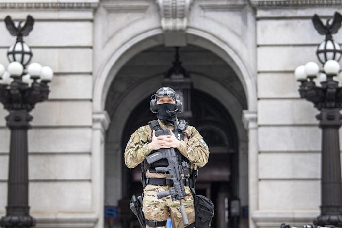 A member of the Pennsylvania Capitol Police guards the entrance to the Pennsylvania Capitol Complex in Harrisburg.