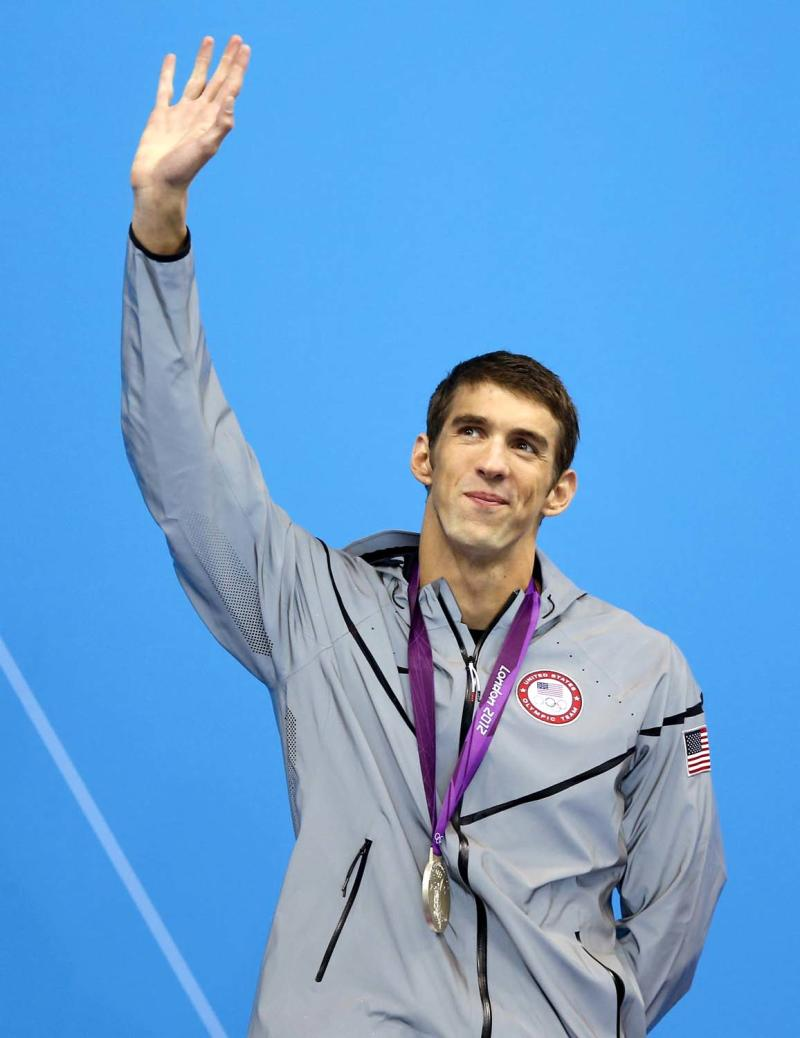 United States' Michael Phelps waves after receiving his silver medal in the men's 200-meter butterfly swimming final at the Aquatics Centre in the Olympic Park during the 2012 Summer Olympics in London, Tuesday, July 31, 2012. (AP Photo/Daniel Ochoa De Olza)
