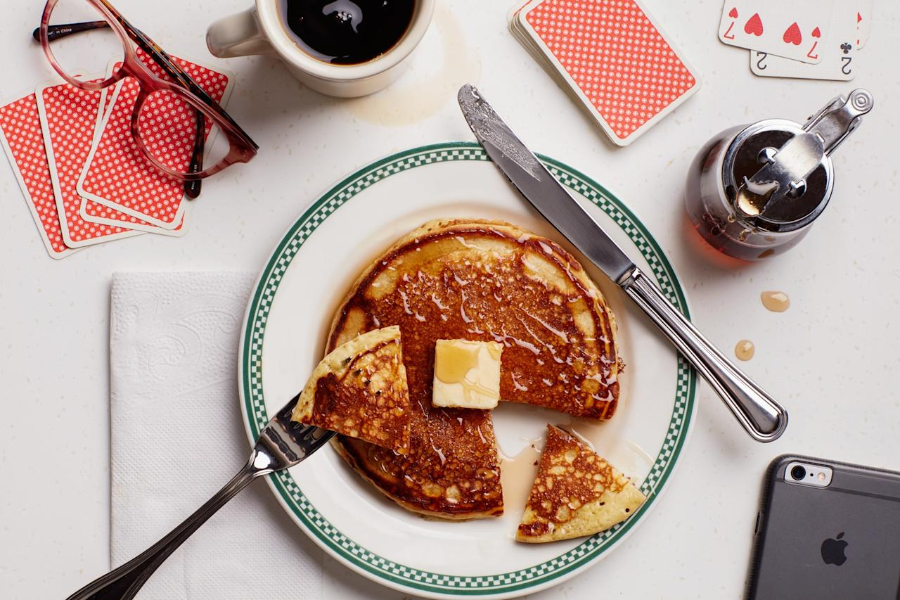 """These pancakes are extra fluffy thanks to a shot of seltzer. <a href=""""https://www.epicurious.com/recipes/food/views/diner-style-buttermilk-pancakes?mbid=synd_yahoo_rss"""">See recipe.</a>"""