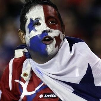 A Panama soccer fan with his face painted cheers at the end of a 2014 World Cup qualifying soccer match against Canada in Panama City, Tuesday, Sept. 11, 2012. Panama won 2-0. (AP Photo/Arnulfo Franco)