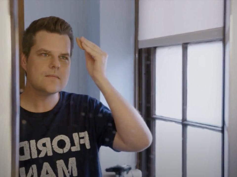 "Florida Representative Matt Gaetz puts makeup before TV interviews at the Capitol in the HBO documentary ""The Swamp"".  (The Swamp, HBO)"