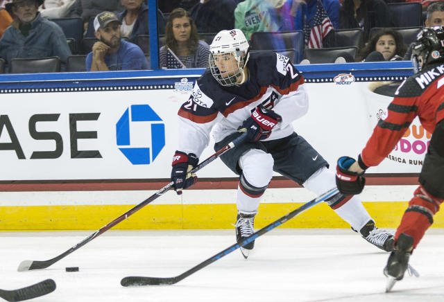 FILE - In this Nov. 12, 2017, file photo, United States' Hilary Knight (21) controls the puck in front of Canada's Meaghan Mikkelson, right, during the second period of the Four Nations Cup championship hockey game in Tampa, Fla. Knight has a gold medal. What she would like is a full-time job. Not just for her. For the other 200-plus members of the Professional Women's Hockey Players' Association too. One that pays all of them well enough to simply go play instead of forcing most to find side gigs just to get by. One that provides adequate medical insurance. One that provides something resembling stability. (AP Photo/Willie J. Allen Jr., File)