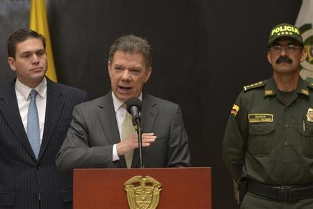 Colombia's President Juan Manuel Santos speaks during an official ceremony at the police headquarters in Bogota