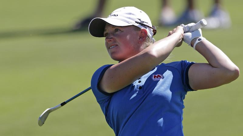 Stacy Lewis watches her approach shot to the 10th green during final round play in the Navistar LPGA Classic golf tournament, Sunday, Sept. 23, 2012, at the Robert Trent Jones Golf Trail in Prattville, Ala.  (AP Photo/Dave Martin)