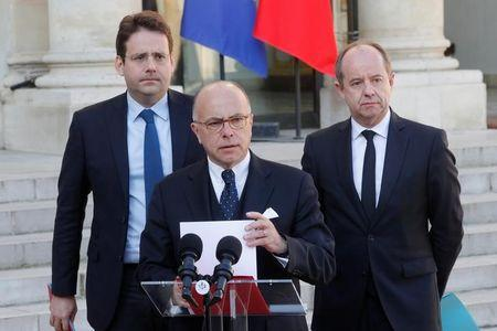 French Prime Minister Bernard Cazeneuve, Justice Minister Jean-Jacques Urvoas and Interior Minister Matthias Fekl  speak at the end of a defence council at the Elysee Palace in Paris